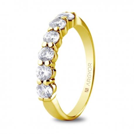 Sortija en oro amarillo de 18kt con seis diamantes de 3mm total 0.60ct.